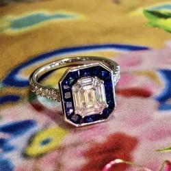 Emerald Cut Diamond and Sapphire halo Ring